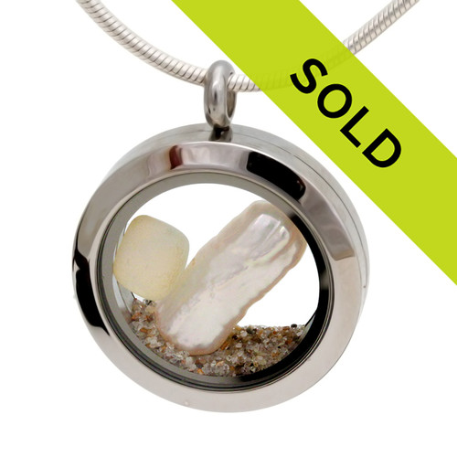 One of the last of our smaller sea glass lockets with VERY RARE Opalized sea glass and a real stick pearl finished with beach sand. A great beachy necklace for anyone specially an November Beach Baby! Sorry this locket has been sold!