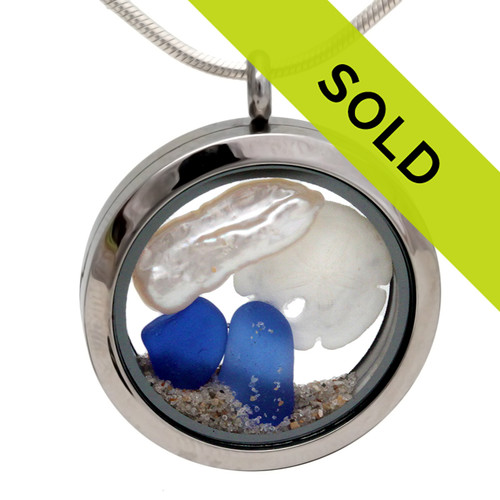 Cobalt Blue beach found sea glass are combined with a small sandollar and a real stick pearl in this one of a kind sea glass locket necklace. SORRY THIS LOCKET HAS SOLD