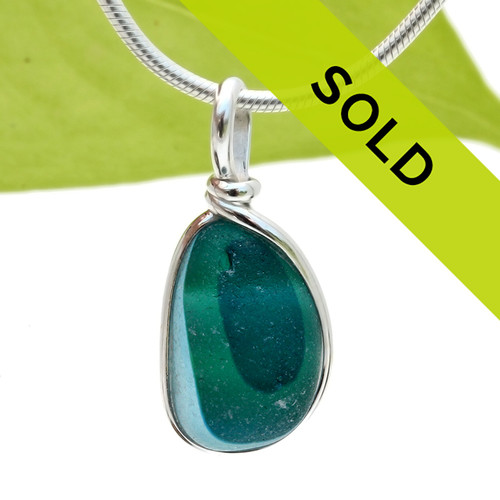 A smaller piece of vivid mixed aqua sea glass set in our Original Wire Bezel Setting. Sorry this one of a kind piece has SOLD!