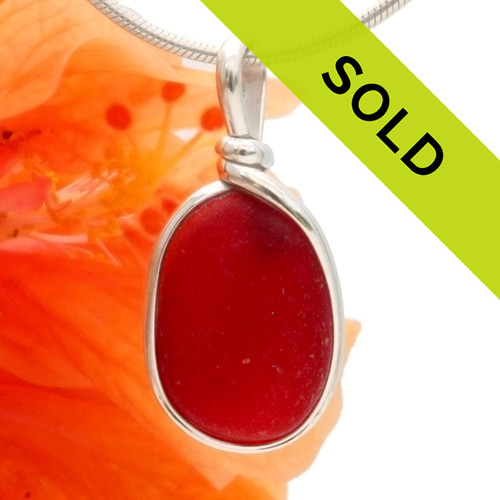A once in a lifetime piece of large bright red sea glass is set in our Orignial Wire Bezel© pendant setting.