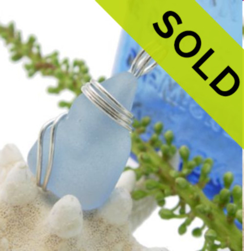 SOLD  A beautiful piece of Outer Banks sea glass in an great Carolina Blue color. This is set securely in a simple sterling setting that leaves much of the glass open so you can feel the tactile texture of this magical glass.