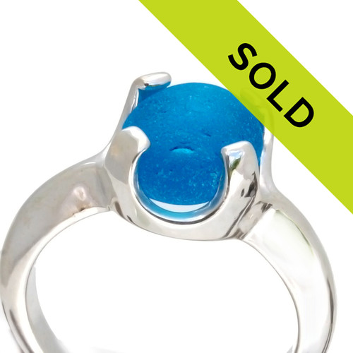 Profile of sea glass in the ring. A great low profile setting for even the most active sea glass lover!