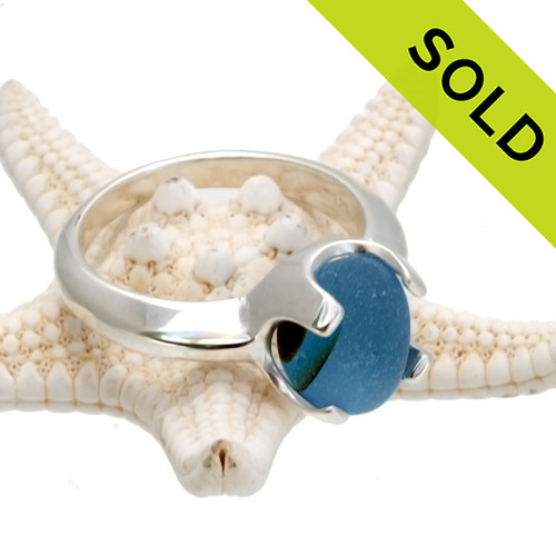 A simple and elegant sterling setting for this Mixed Multi Blue sea glass ring that is just the way it was found on the beach. This is set in a solid sterling hand cast 4 prong ring that is perfect for the most active of sea glass lovers.   SOLD - Sorry this Ultra Rare Sea Glass Ring is NO LONGER AVAILABLE!