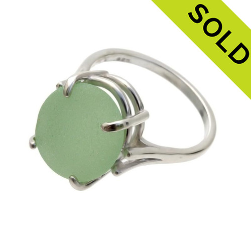 An UNALTERED piece of seafoam green sea glass set in a ring.