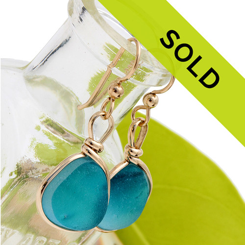 A mixture of vivid electric aqua blue tones in this Victorian era sea glass earring pair. Unique and special!