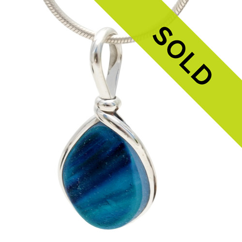 An amazing combination of vivid mixed  blue in this very old English Sea Glass piece and set in our Original Wire Bezel© necklace pendant setting. Sorry this pendant has sold