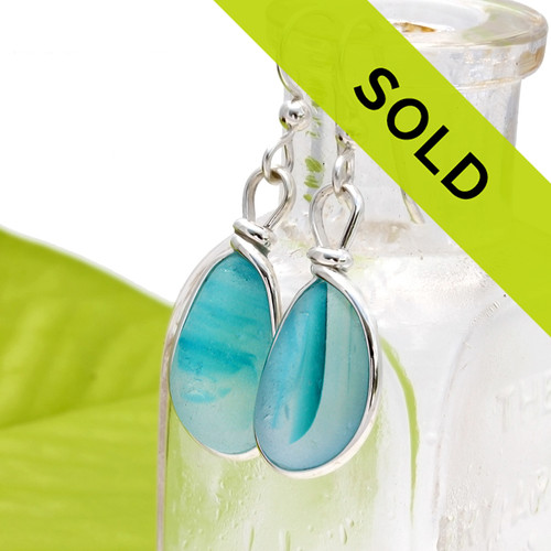 Deep vivid Electric Aqua Victorian Sea Glass pieces from Seaham England are set in our Original Wire Bezel© earring setting. This is a very hard sea glass to match and this photo is true to color, subtle variances in the aqua shade can be seen. Sorry these earrings have sold!