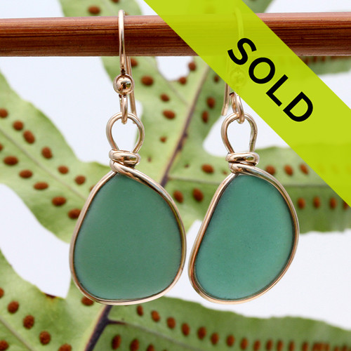 Sorry this pair of sea glass earrings is no longer for sale.  Natural Genuine beach found sea glass pieces in an unusual teal green expertly wrapped in 14K Goldfilled bezel for a lovely classic pair of genuine beach found sea glass earrings!  This is a perfect sea glass in a natural state, just the way it was found on the beach - Our Original version and leaves both front and back open without destroying the integrity of the sea glass. Though a common color of sea glass this pair is exceptional.