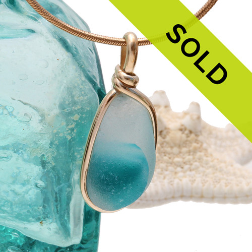 An amazing combination of vivid electric aqua and white or clear in this very old English Sea Glass piece and set in our Original Wire Bezel© necklace pendant setting. Sorry this piece has sold!