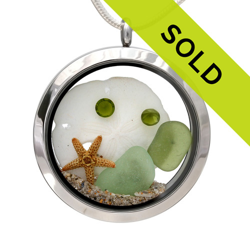 Genuine seafoam and peridot green sea glass pieces combined with a real starfish, a sand dollar and real beach sand in this JUMBO 35MM stainless steel locket. Great gift for August Birthdays!!! Sorry this sea glass jewelry item has been sold!
