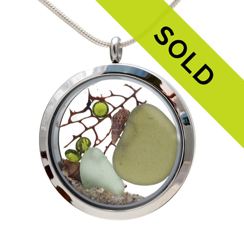 Genuine seafoam and peridot green sea glass pieces combined with a sea fan, shells and real beach sand in this JUMBO 35MM stainless steel locket. Great gift for August Birthdays!!!