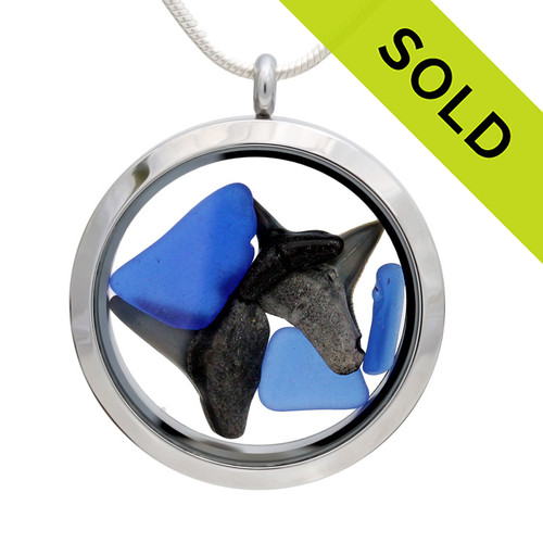 Genuine blue sea glass pieces combined with a real sharks teeth in this JUMBO 35MM stainless steel locket. Sorry this sea glass selection has been sold!