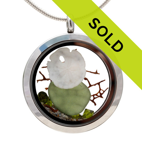 Vivid Peridot Green sea glass combined with a real sandollar, and beach sand and brightened up with a ton of peridot gems.  Great choice for an August Birthday! Sorry this jewelry has been sold!
