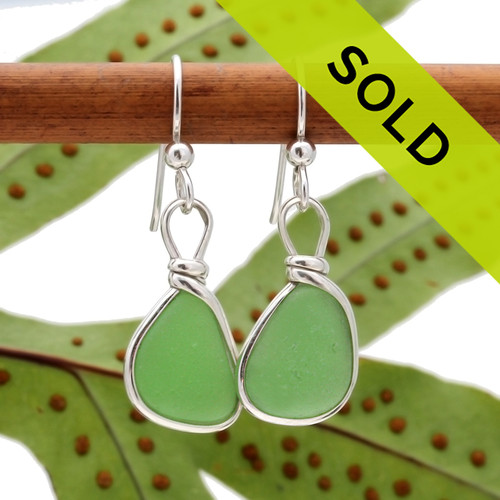 Vivid genuine green sea glass pieces set in our signature Original Wire Bezel© setting and presented on solid sterling ear wires. Other earring options are available.