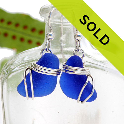 Sorry these earrings have been sold! Blue beach found sea glass pieces set in a triple sterling silver setting! A nice pair of genuine blue sea glass earrings.