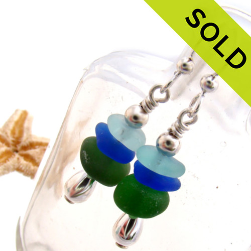 Beautiful Genuine Sea Glass Earrings with glass from England, Hawaii and Puerto Rico shaped ONLY by tide and time. Bright green, cobalt blue and aqua green sea glass combined with sterling teardrop beads for a polished professional look make this a great pair that will do with many outfits. SOLD - Sorry these Sea Glass Earrings are NO LONGER AVAILABLE!
