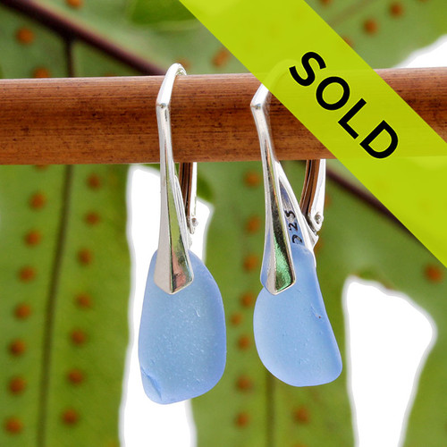 A stunning petite and lightweight pair of genuine sea glass earrings in blue.