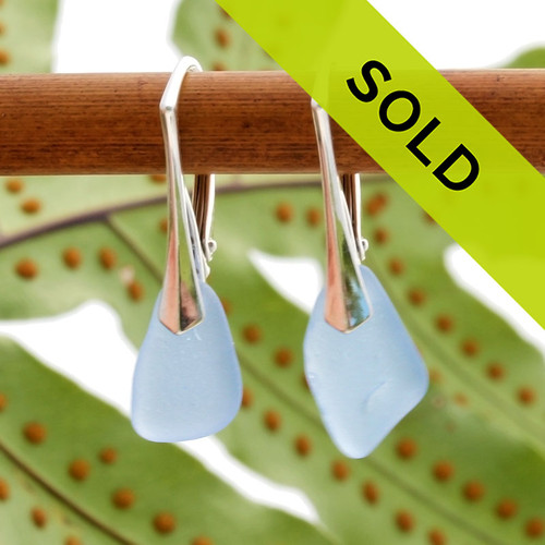 A stunning petite and lightweight pair of Carolina Blue genuine sea glass earrings on sterling leverbacks.