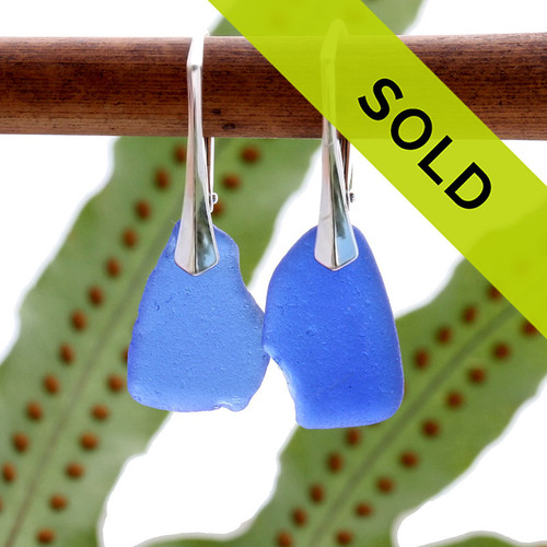 A stunning petite and lightweight pair of genuine sea glass earrings in blue and silver. Sorry this sea  glass jewelry selection has been sold!
