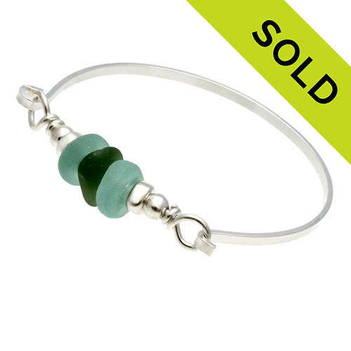 A Seaweed Green sea glass piece set with a aqua recycled green glass beads set with sterling details on a solid sterling flat bangle bracelet. Sorry this Sea Glass Jewelry selection is NO LONGER AVAILABLE.
