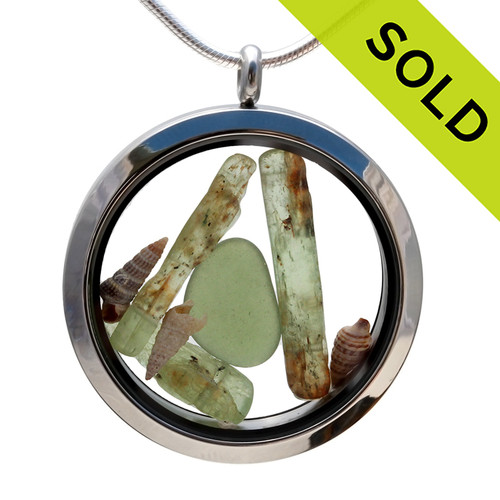 Genuine peridot or olive green sea glass piece combined with a real shells and a real beach sand in this JUMBO 35MM stainless steel locket.