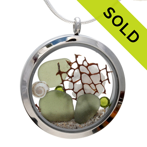 Genuine peridot or olive green sea glass piece combined with a real shells, sea fan, sandollar and a real beach sand in this JUMBO 35MM stainless steel locket. SOLD - Sorry this Sea Glass Jewelry selection is no longer available.