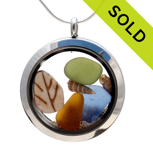 Genuine amber and green and blue sea glass piece combined with a real shells and a fall leave bead in this stainless steel locket necklace. SOLD - Sorry This Sea Glass Jewelry Selection Is NO LONGER AVAILABLE!