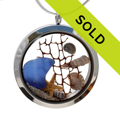 Genuine blue beach found sea glass pieces combined with a real starfish, shells, sea fan and sand in this JUMBO 35MM stainless steel locket. Sorry this locket is no longer for sale.