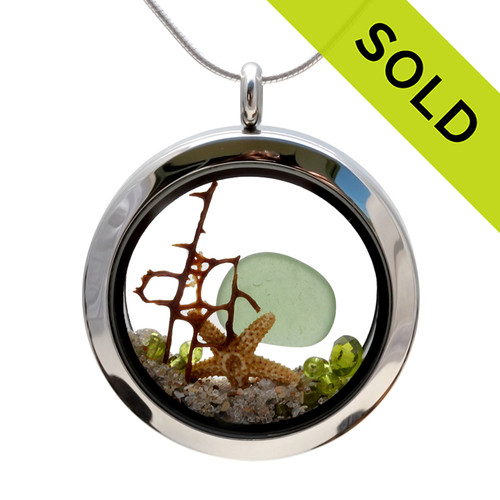 Vivid Peridot Green sea glass combined with a piece of vintage seafan, and beach sand and brightened up with a ton of peridot gems. Great choice for an August Birthday! SOLD - Sorry this Sea Glass Locket is NO LONGER AVAILABLE!