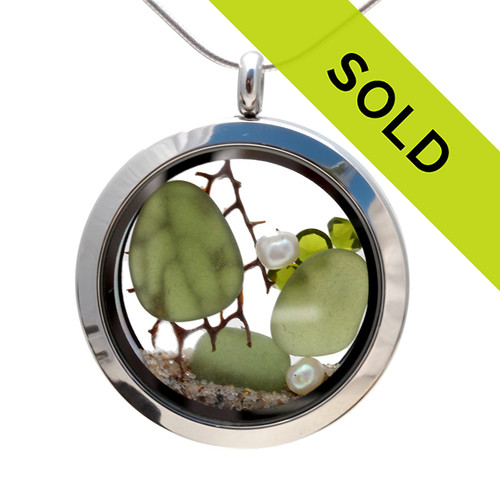 Vivid Peridot Green sea glass combined with a piece of vintage seafan, and beach sand and brightened up with a ton of peridot gems.  Great choice for an August Birthday! Pearls are the Birthstone for October. Sorry this sea glass jewelry piece has been sold!