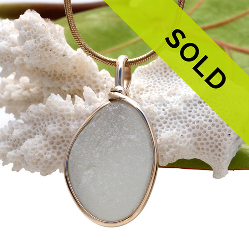 A pure white natural sea glass piece set in our Original Wire Bezel setting in 14K Rolled Gold setting. Sorry this sea glass pendant has been sold!