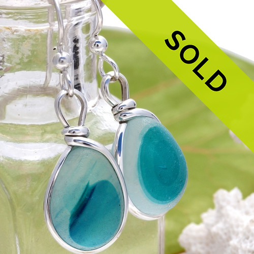 Vivid Aqua mixed sea glass pieces from Seaham England are set in our Original Wire Bezel© earring setting. This is a very hard sea glass to match and this photo is true to color.  Sorry this sea glass jewelry selection has been sold!