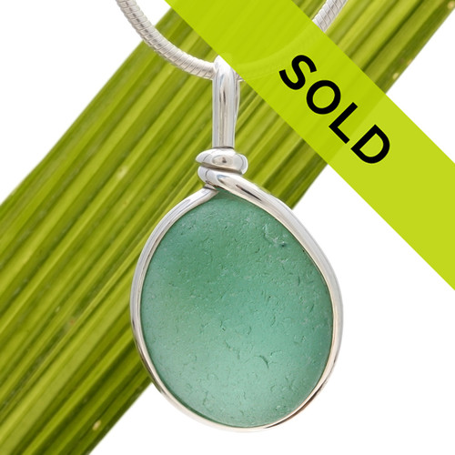 This is a great setting that leaves the sea glass piece TOTALLY UNALTERED from the way it was found on the beach in the UK! Sorry this jewelry piece has been sold!