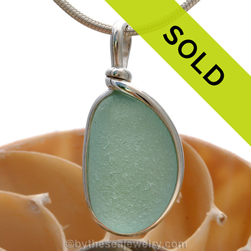 This is a great setting that leaves the sea glass piece TOTALLY UNALTERED from the way it was found on the beach in the UK! Sorry this sea glass jewelry piece has been SOLD!/