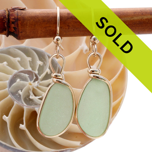 Genuine beach found seafoam green sea glass earrings in a 14K Rolled Gold Original Wire Bezel setting. Sorry this sea glass jewelry item is no longer avaiable.