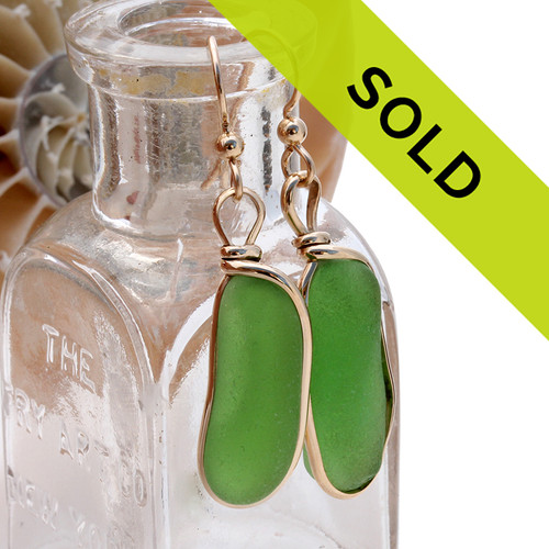 Genuine beach found vivid green sea glass earrings in a 14K Rolled Gold Original Wire Bezel setting. Sorry this sea glass jewelry is no longer available!