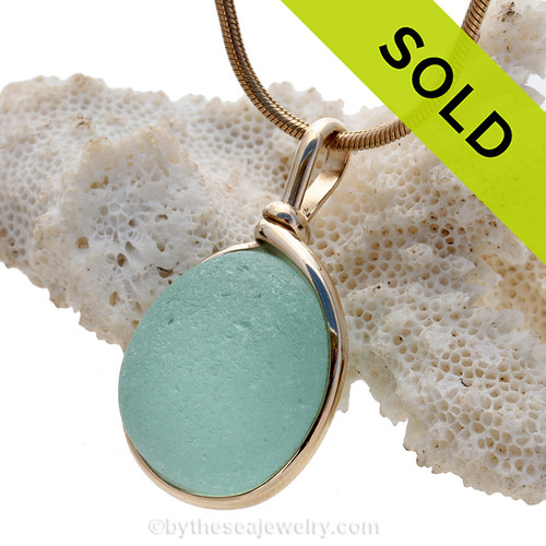 A nice piece of aqua green sea glass with in our signature Original Wire Bezel© pendant setting that leaves both front and back open and the glass unaltered from the way it was found on the beach. Sorry this Sea Glass Jewelry selection has been sold!