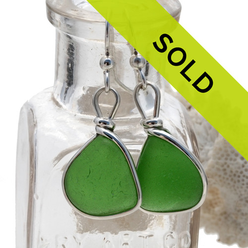 Perfect triangular pieces of all natural genuine sea glass earrings in a Emerald Green in our original Wire Bezel© Earring Setting. Our jew Sorry this sea glass jewelry item has been sold!