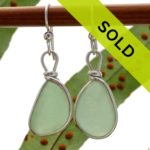 Perfect pieces of all natural genuine sea glass in a bright seafoam green and set in our original Wire Bezel© Sea Glass Earring Setting.  Sorry this sea glass jewelry item has been sold!