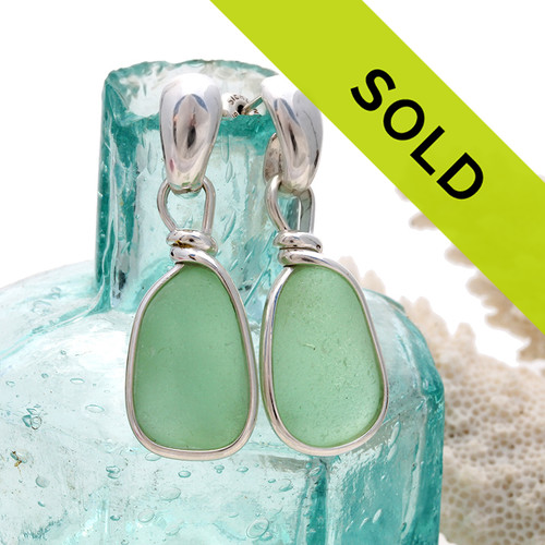 Perfect pieces of all natural genuine sea glass in a bright seafoam green and set in our original Wire Bezel© Sea Glass Earring Setting presented on solid sterling silver posts. Sorry this sea glass jewelry item has been sold!