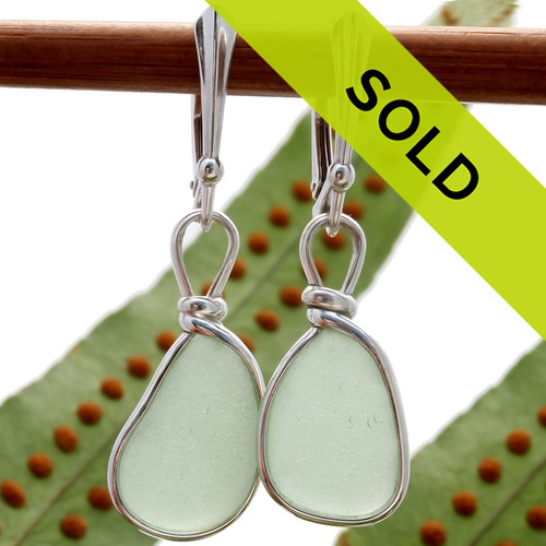 Perfect pieces of all natural genuine sea glass in a bright seafoam green and set in our original Wire Bezel© Sea Glass Earring Setting presented on solid sterling silver leverbacks. Sorry this pair of sea glass earrings has sold!