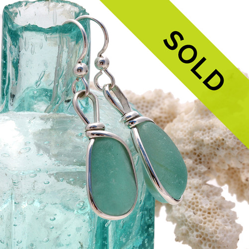 Sorry these sea glass earrings in aqua and silver bezel have been sold!