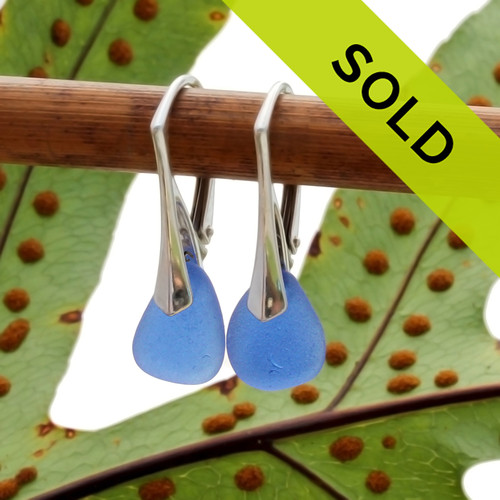 A great pair of petite blue sea glass lever back earrings for any sea glass lover! Sorry this sea glass jewelry item has been sold!