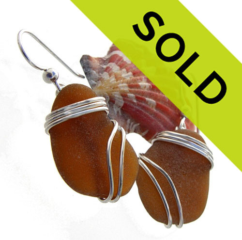 Larger perfect pieces of rich amber sea glass earrings set in our triple silver earring setting.