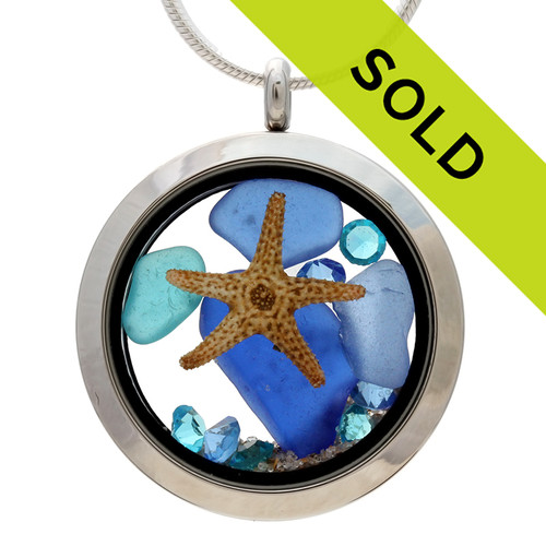 Sorry this Real beach found blue and electric aqua sea glass and a real starfish in this Stainless steel locket has been SOLD!