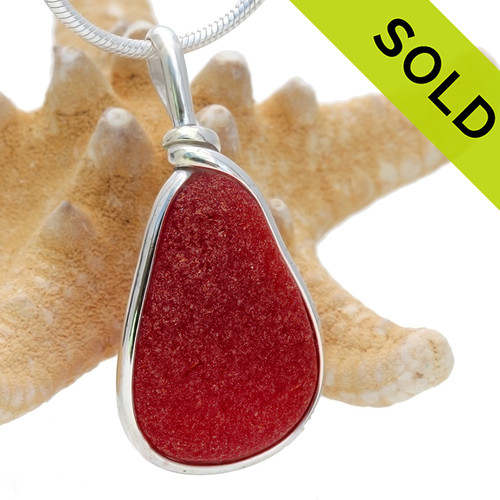 A once in a lifetime piece of large bright red sea glass is set in our Original Wire Bezel© pendant setting. An absolutely PERFECT piece of highly frosted English sea glass. SOLD - Sorry this Ultra Rare Sea Glass Pendant is NO LONGER AVAILABLE!