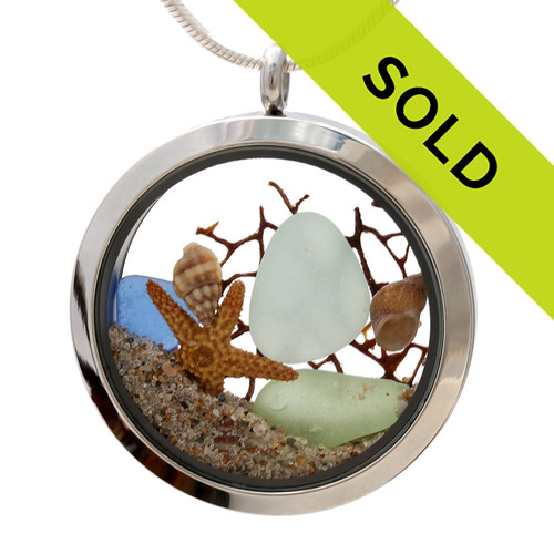 Genuine sea green sea, pale aqua and blue glass piece combined with a real shells, sea fan, starfish. Finished with real beach sand in this JUMBO 35MM stainless steel locket. Sorry this piece has sold!