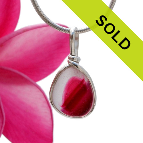A vivid mix of hot pink and pure white Victorian Endoday sea glass from England set in our Original Wire Bezel© necklace pendant setting.