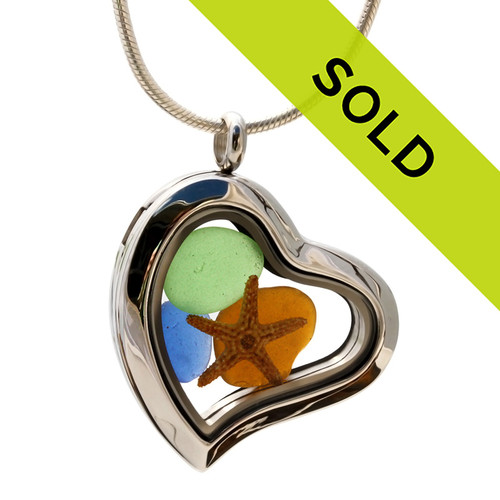 Blue , green and amber brown beach found sea glass combined with a real starfish in this magnetic heart shaped stainless steel locket necklace!  Sorry this sea glass jewelry item has been sold!