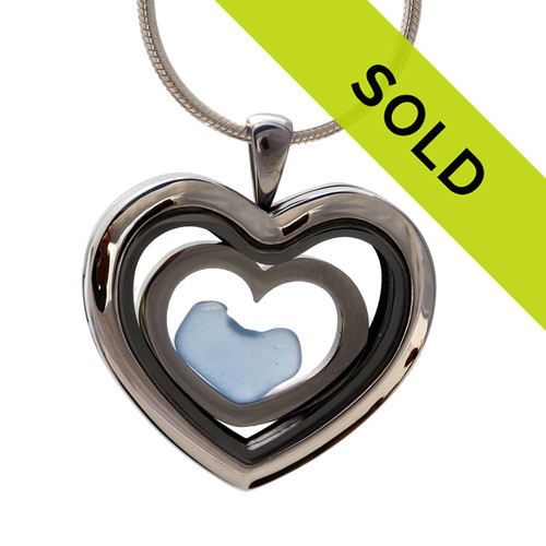 A heart in heart sea glass locket with blue sea glass. Sorry this sea glass jewelry piece has been sold!